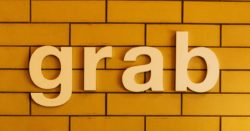 "Sign on a brick wall saying ""Grab"""