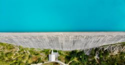Arial view of a dam without any water flowing